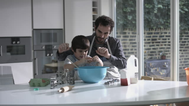Father and son cooking biscuits