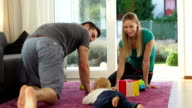 father and son crawling to mom