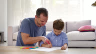 Father and son drawing at home