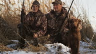 father and son duck hunting