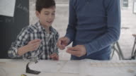 Father and son making a toy plane