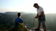Father and son organize climbing gear