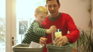 Father and son sorting recyclable materials