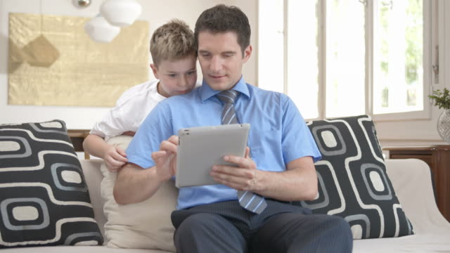 HD DOLLY: Father And Son Taking Photos With Digital Tablet
