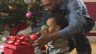 MS TU Father and toddler decorating Xmas Tree / Newark, New Jersey, USA