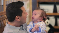 CU Father carrying baby boy (2-5 months) in nursery room / Richmond, Virginia, USA.