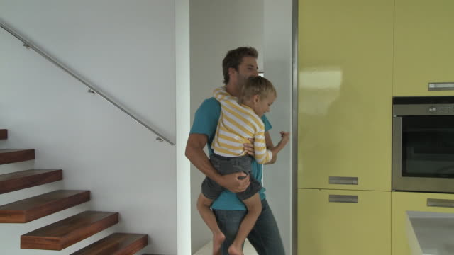 Ws pan father carrying son to kitchen to see birthday cake for Kitchen worktops cape town