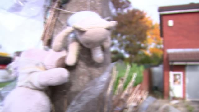 Father convicted of murdering his 13 day old son ENGLAND Midlands Wolverhampton EXT Toys and floral tributes tied to tree PAN house where Joshua...