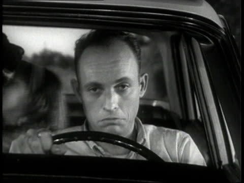 1963 MS Father driving family in car / United States