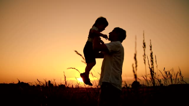SLO MO Father embrace his son at sunset