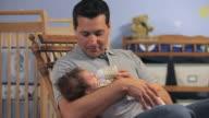 MS Father feeding baby boy (2-5 months) from bottle in nursery room / Richmond, Virginia, USA.