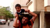 Father giving piggyback ride to his son