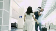 WS Father greets small daughter and wife at airport