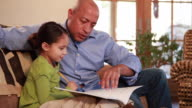 MS Father helping daughter (6-7) in doing homework / Lamy, New Mexico, USA