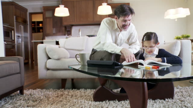 Father helps daughter with home work