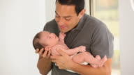 MS TU Father Holding Newborn Baby / Richmond, Virginia, USA
