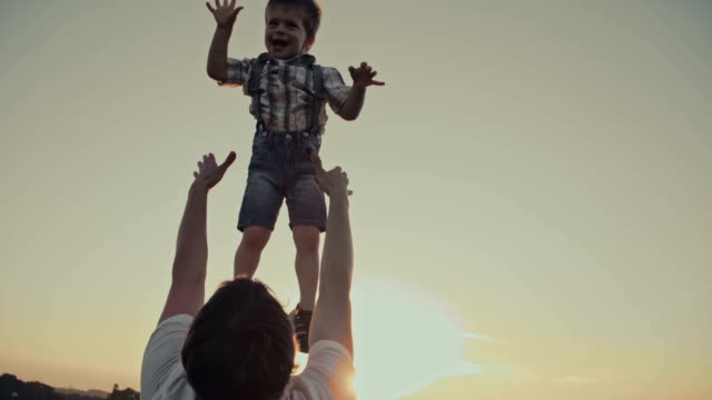 SLO MO Father lifting his son up