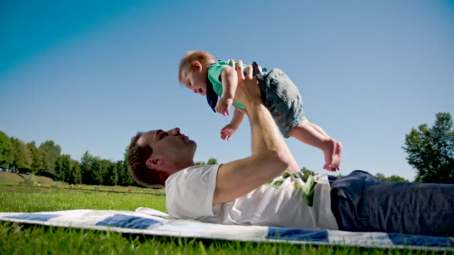 MS Father Lifting Up Baby