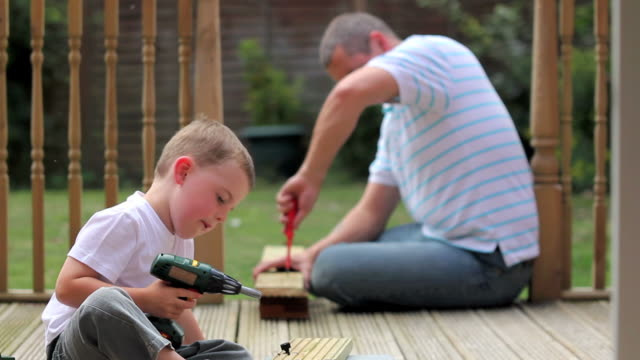 Father teaches son some home improvement skills