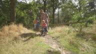 Father teaching cycling