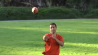 A father teaching his sons how to play American football.  - Super Slow Motion - filmed at 240 fps