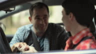 MS R/F Father teaching teenage boy (16-17) to drive / Neenah, Wisconsin, USA