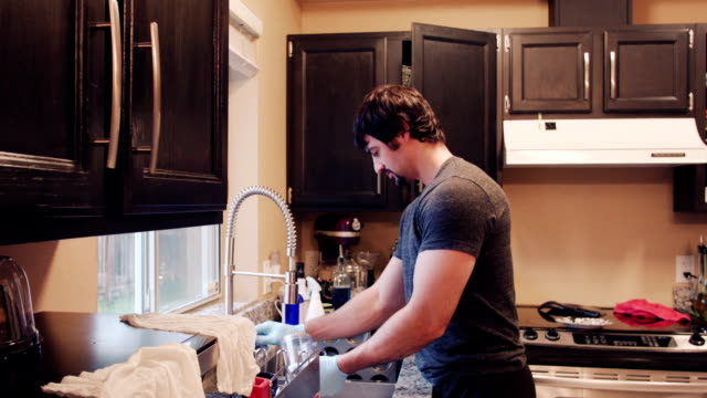Father Washing Dishes in His Home