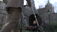 CU LA PAN Father with daughter (6-11 months) in pram, New York City, New York, USA