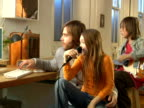 MS,   Father with two children  (8-9,  10-11)  playing and singing at home