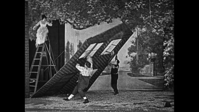Fatty Arbuckle directs Buster Keaton to help him reconstruct a fallen set, but they are unsuccessful and another set starts to falls over, causing the audience to laugh