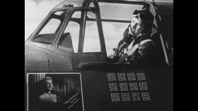 Faye Marlowe speaks to a combat pilot from her photograph hanging in the cockpit