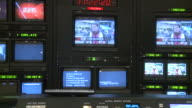 February 14 2009 WS Controllers watching multiple TV screens and computers during filming of an interview show discussing banking and GST sales tax /...