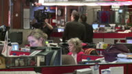 February 14 2009 MONTAGE Employees working in a media control room and in a newsroom / Canada
