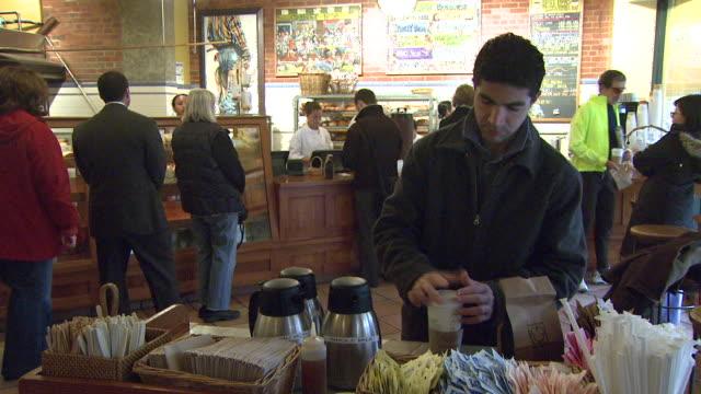 February 2 2009 TS Customer preparing coffee at a counter at Best Buns / Arlington Virginia United States