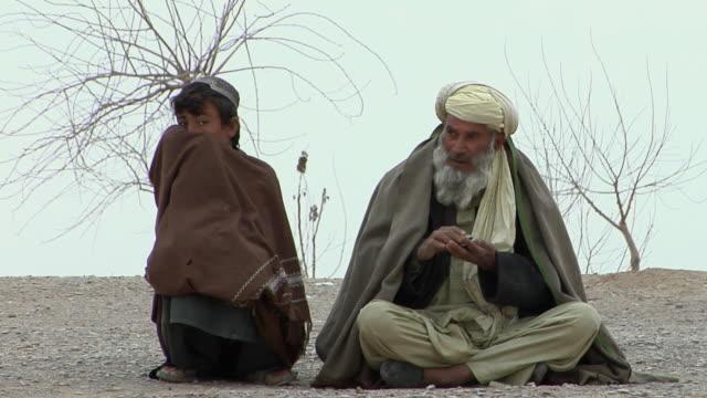 February 2009 MS Two rural residence sitting in desert / Bakwa Farah Province Afghanistan