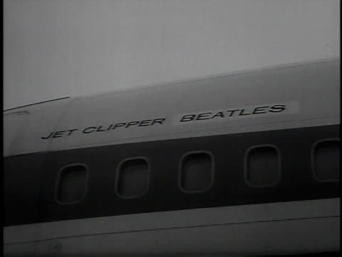 February 22 1964 MONTAGE fans waiting for The Beatles at London Heathrow Airport Beatles exiting plane and waving to crowd / London United Kingdom...