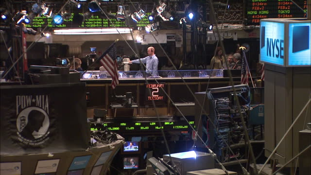 February 23 2010 MONTAGE Traders working at the New York Stock Exchange with the ticker symbol data feed running / New York City New York United...