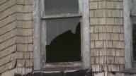 February 29 2008 ZO Abandoned older gabled house with broken windows / Baltimore Maryland United States