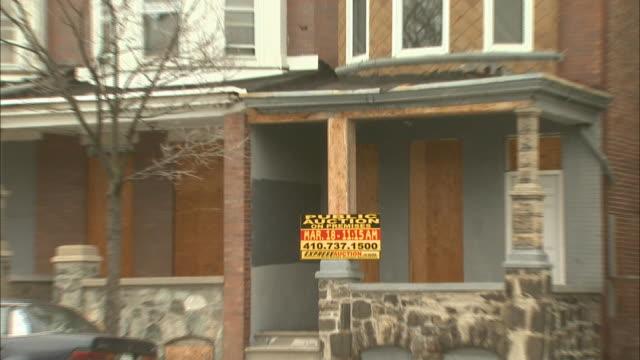 February 29 2008 ZO 'PUBLIC AUCTION sign on dilapidated row house / Baltimore Maryland United States