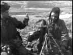 February 5 1951 MONTAGE Soldiers firing artillery / Korea