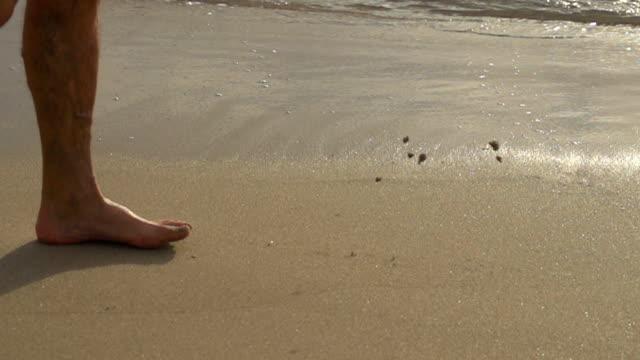 HD SUPER SLOW MOTION: Feet Walking In Sand
