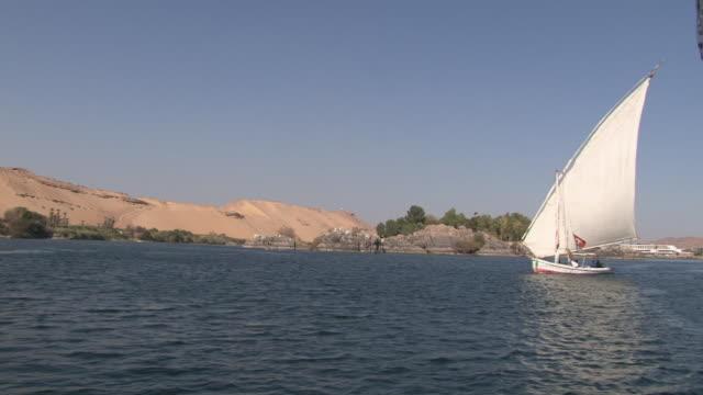WS PAN Fellucas cruising on river  / Assuan, Egypt