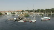 WS Feluccas docked on rocky island, harbor of Aswan, Egypt