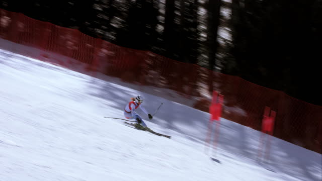 TS Female alpine skier competing in a giant slalom race