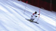TS Female alpine skier passing the gates in a slalom race