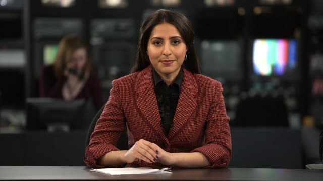 MS Female anchor speaking at news desk, Dallas, Texas, USA