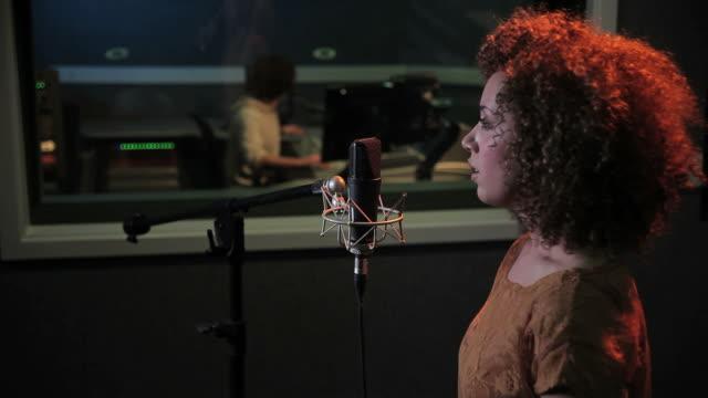 Female and  technician in recording studio