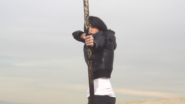 A female archer shooting targets with her bow and arrow.  - Slow Motion - filmed at 480 fps