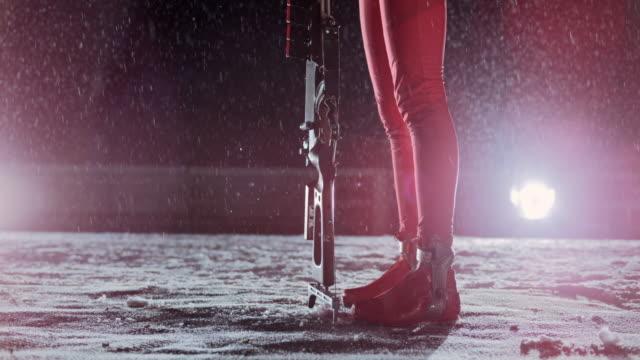 SLO MO female athlete holding her biathlon rifle