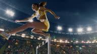 Female athlete hurdle on sports race